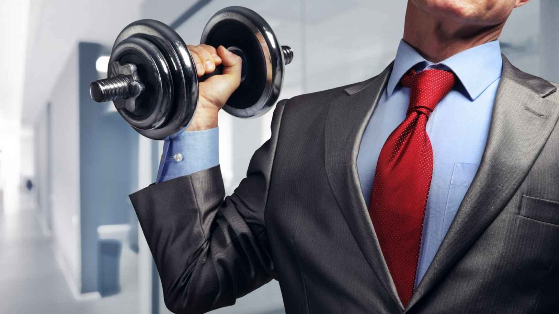 image of a headless man in a suit with dumbell weights, red tie, blue shirt, grey jacket for lockdown work from home blog